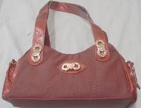Ladies simple hand bag in maroon color